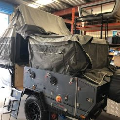 camper trailer set up in workshop